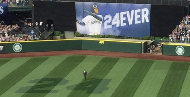 Ken Griffey Jr. emerging from center field as he gets his number retired