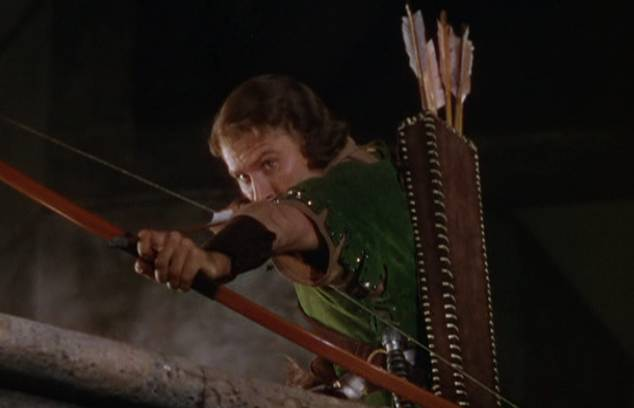 Errol Flynn as Robin Hood shoots an arrow