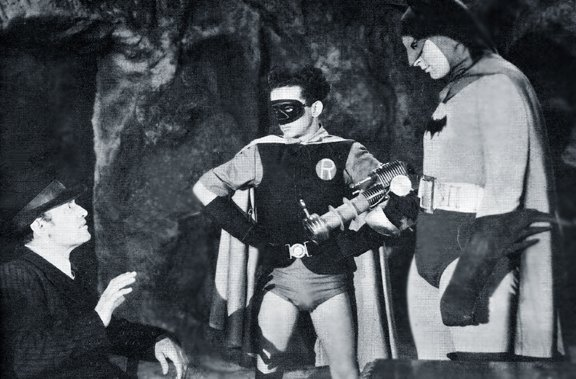 "Batman, Robin and crook, in the ""Bat's Cave,"" in the 1943 serial ""Batman"""