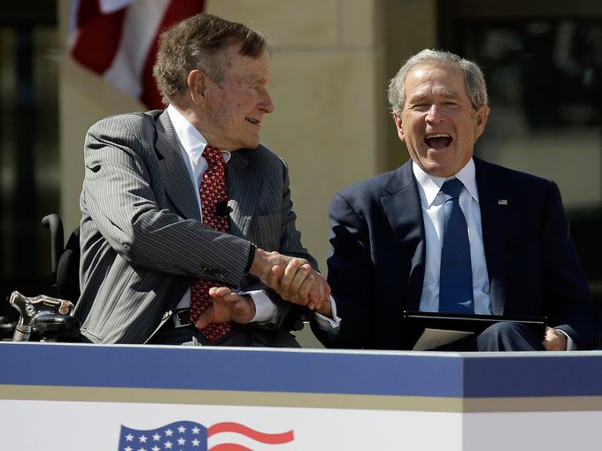 George H.W. Bush and George W. Bush at the opening of the latter's presidential library