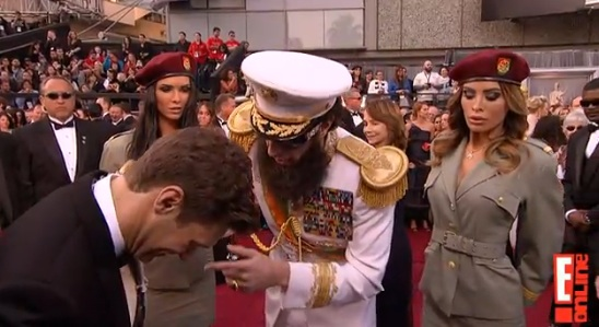 Ryan Seacrest and Sasha Baron Cohen on the red carpet. Cohen is the one with a sense  of humor.