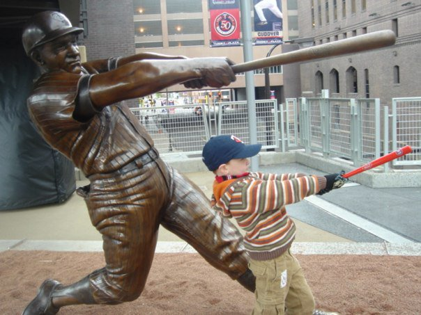 The statue of Harmon Killebrew, who hit 573 homeruns and retired fifth on the all-time homerun list, at Target Field. My nephew Ryan, emulating, hitting his first.
