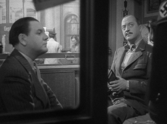 "Charters and Caldicott in a scene from ""Night Train to Munich"""