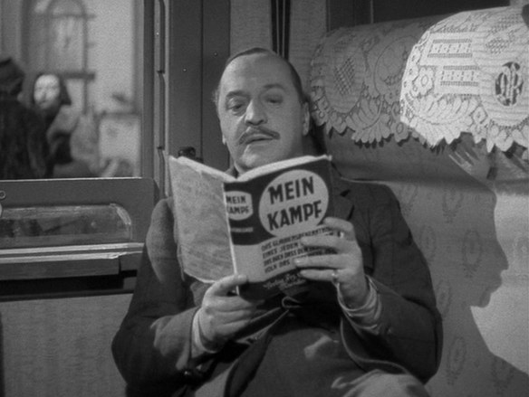 "Charters reading ""Mein Kampf"" in Carol Reed's ""Night Train to Munich"""