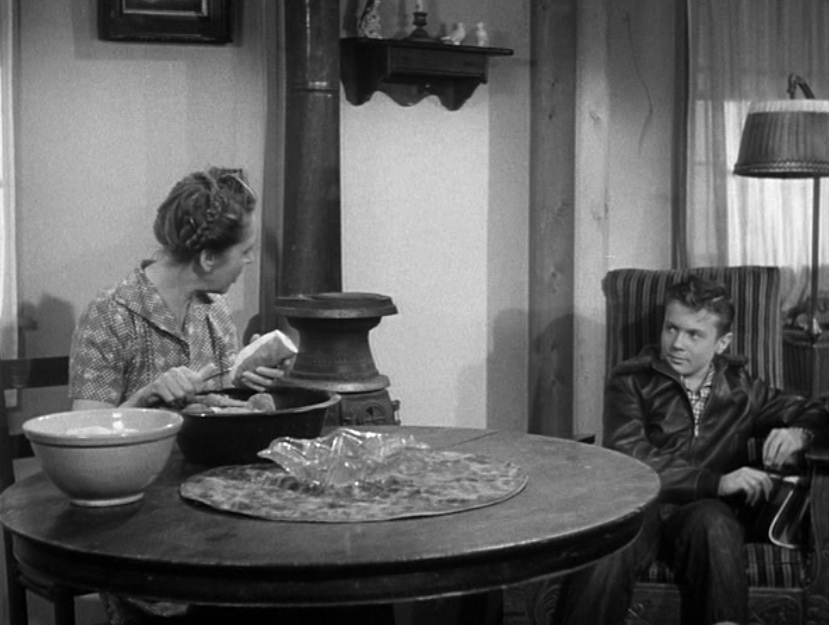 "Clark Kent (Jeffrey Silver) having a heart-to-heart with his mother (Frances Morris) in the first episode of the ""Adventures of Superman"" TV series, 1952"