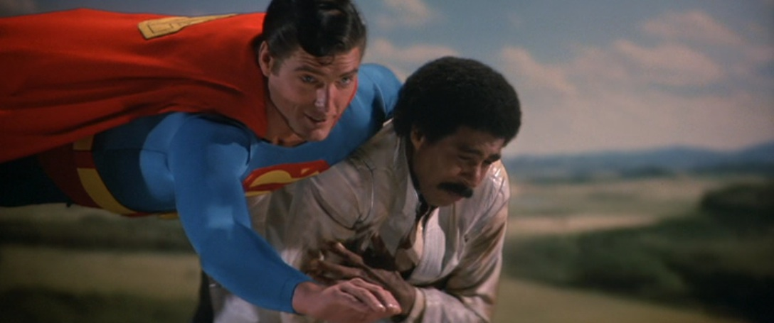 Superman carrying Richard Pryor