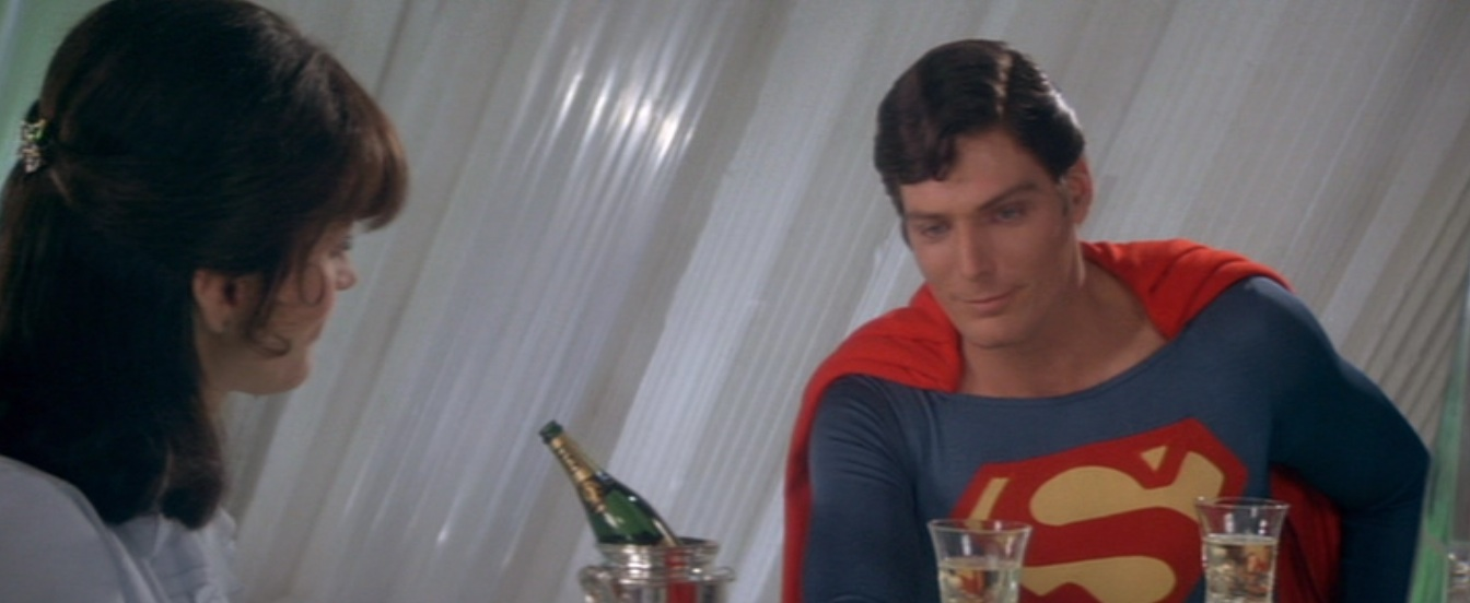 Superman and Lois and a bottle of champagne in the Fortress of Solitude