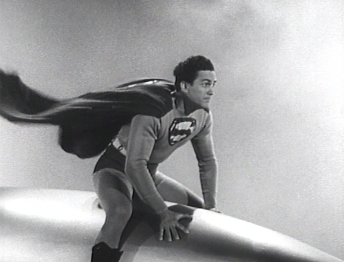 "Superman (Kirk Alyn) riding a missle or rocket in ""Atom Man vs. Superman"" (1950)"