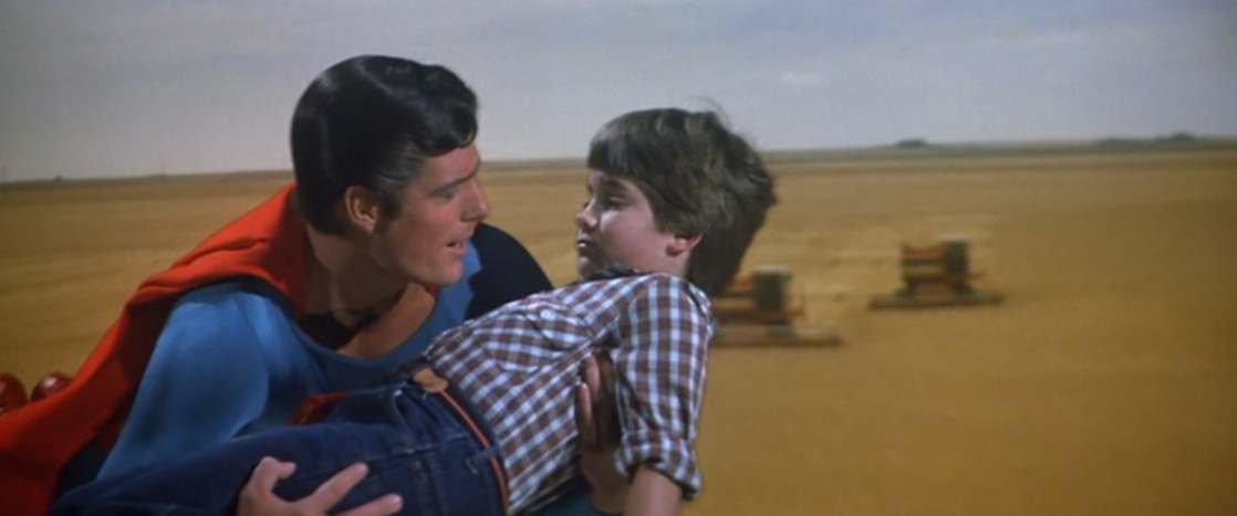 Superman carrying Ricky after the thresher in Superman III