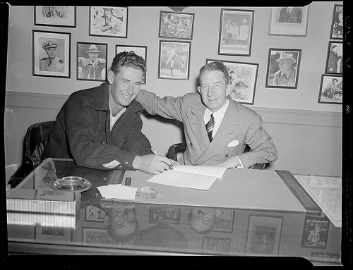 Ted Wiliams signing contract with Eddie Collins. Photograph by Leslie Jones