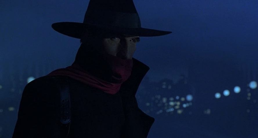 "Alec Baldwin as The Shadow, making his first appearance in ""The Shadow"" (1994)"