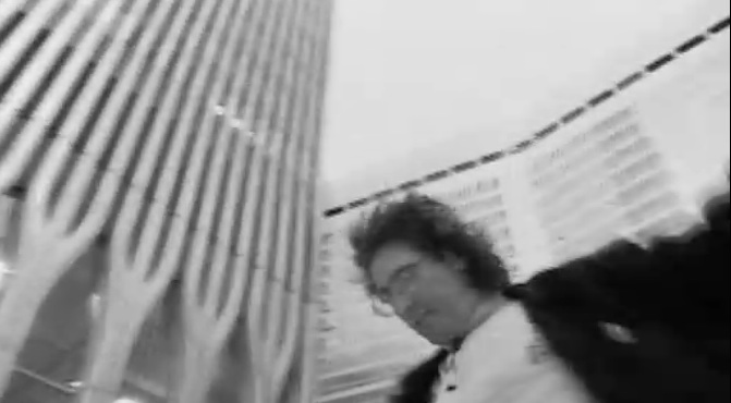 "Timothy ""Speed"" Levitch, spinning between the twin towers in ""The Cruise"" (1999)"