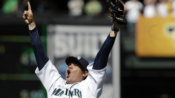 Felix Hernandez celebrates after throwing the first perfect game in Mariners history: August 15, 2012