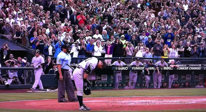 Ichiro Suzuki, in Yankee road gray, bows to the Safeco Field crowd before his first at-bat: July 23, 2012.