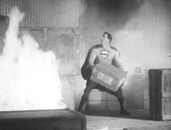 "Superman battling fire in ""Atom Man vs. Superman"" (1950)"