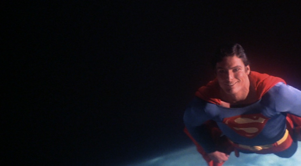 "The ending to ""Superman: The Movie"": Superman smiles at camera"